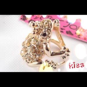 Betsy Johnson rose gold ring.